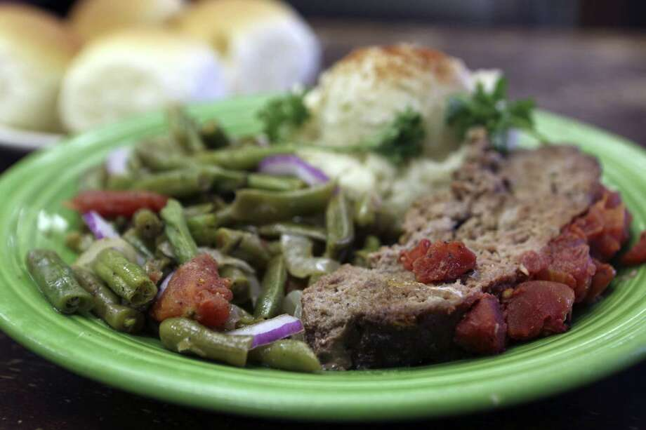 The meatloaf at Joseph's Storehouse is served with tomato-rich green beans and mashed potatoes topped with paprika. Photo: Photos By Helen L. Montoya / San Antonio Express-News
