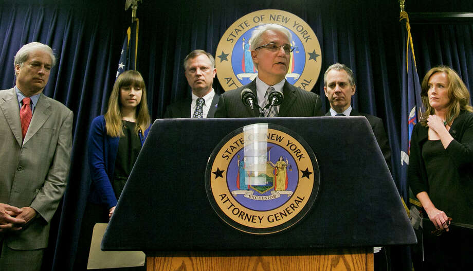 "Citizens Crime Commission of New York president Richard Aborn, far left, Annie Palazzolo, second from left, and her father Paul Boke, third from left, New York Attorney General Eric Schneiderman, second from right and Nassau County, N.Y. Distrct Attorney Kathleen Rice, far right, listens as  San Francisco District Attorney George Gascon speaks during a press conference on Thursday, June 13, 2013, in New York.   The group announced the launch of what they call the ""Secure Our Smartphones Initiative"" aimed at encouraging the cell phone industry to adapt technology to deter cellphone theft.  Palazzolo, 29, spoke about her sister who was killed for her cellphone. (AP Photo/Bebeto Matthews) Photo: Bebeto Matthews"