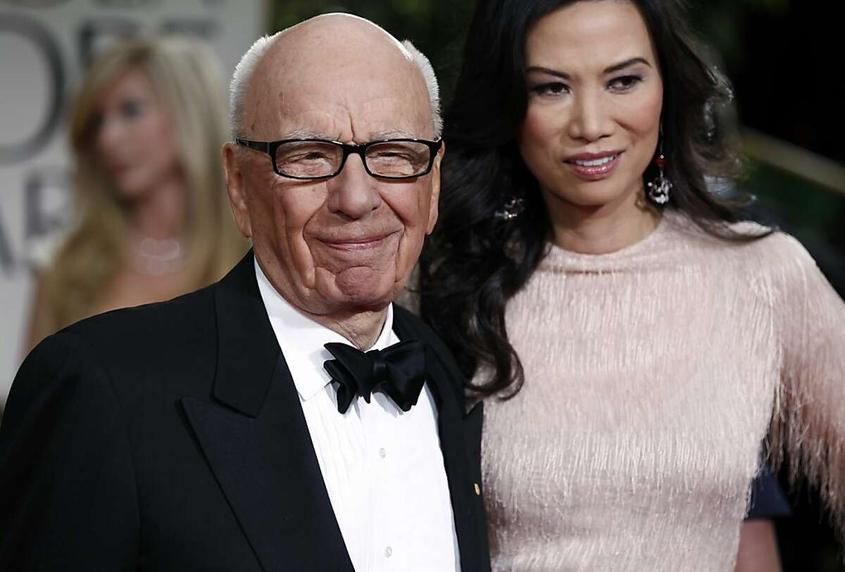 In this Sunday, Jan. 15, 2012, file photo, Rupert Murdoch and his wife Wendi arrive at the 69th Annual Golden Globe Awards in Los Angeles. Murdoch filed Thursday, June 13, 2013, for divorce from Wendi Deng Murdoch, his wife since 1999.(AP Photo/Matt Sayles, File)