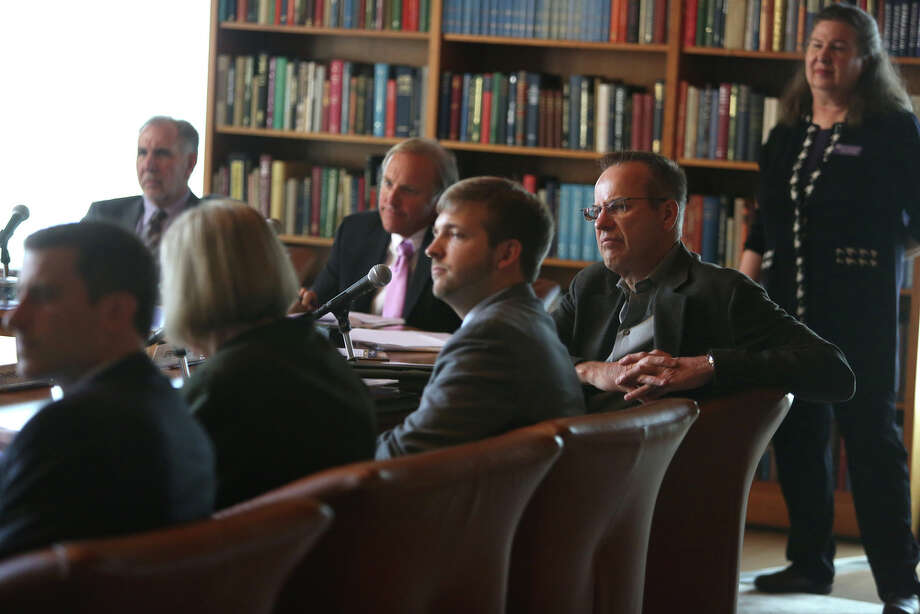 Regents and staff listen during a meeting of the University of Washington Board of Regents on Thursday, June 13, 2013. Students gathered during the meeting to ask the school to divest the university's investment portfolio of all stocks in big oil, big coal, and all companies involved in the fossil-fuel economy. Photo: JOSHUA TRUJILLO, SEATTLEPI.COM / SEATTLEPI.COM