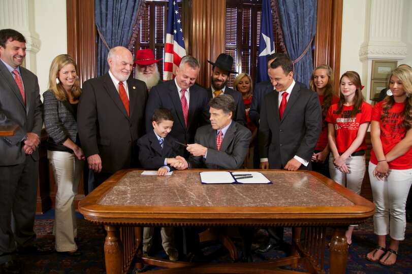 Gov. Rick Perry signs HB 308, also called the Merry Christmas Bill, on June 13, 2013, in Austin.  (p