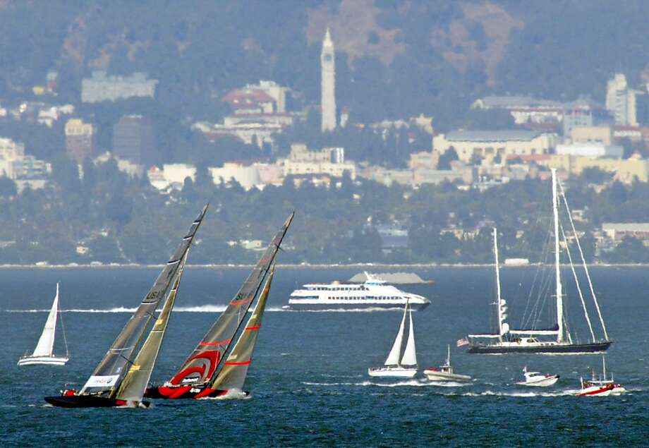 Ernesto Bertarelli and Larry Ellison race across San Francisco Bay in a rematch of their 2003 America's Cup competition, won by Bertarelli's Alinghi team. Photo: Eric Risberg, AP