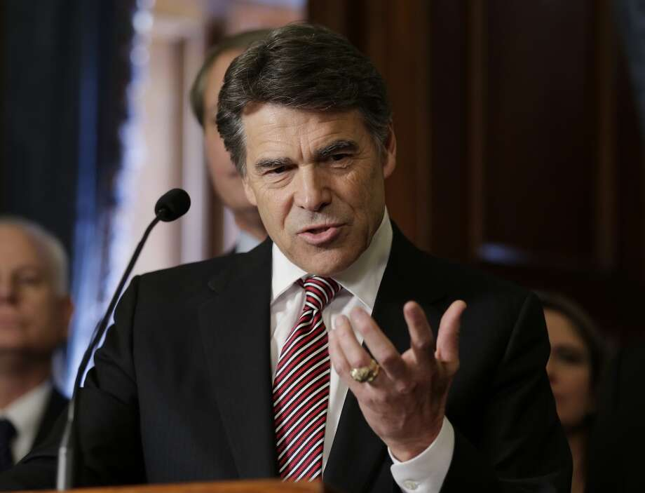 FILE - In this May 28, 2013 file photo, Gov. Rick Perry speaks during a ceremonial signing of a water fund bill, in Austin, Texas. Perry plans to announce any day if he will seek re-election next year. But that decision could depend as much on whether he wants to run for president again in 2016 as it does his desire to stay in the governor's mansion. (AP Photo/Eric Gay, File) Photo: Eric Gay, Associated Press