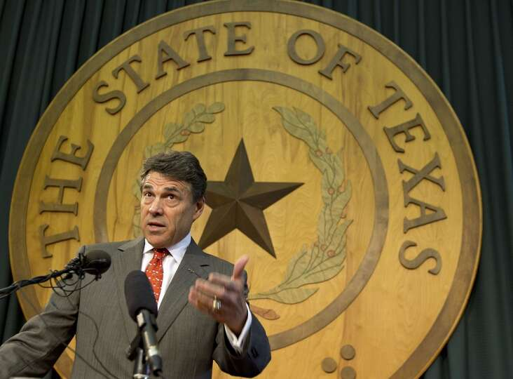 FILE - In this July 17, 2012 file photo, Texas Gov. Rick Perry speaks to members of the media at the