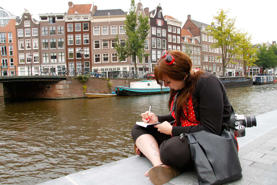 Jotting down thoughts about your physical surroundings and sensory experiences, as well as your emotions and feelings at the time, will allow you to revisit a place time and time again. Photo: Laura VanDeventer, Ricksteves.com