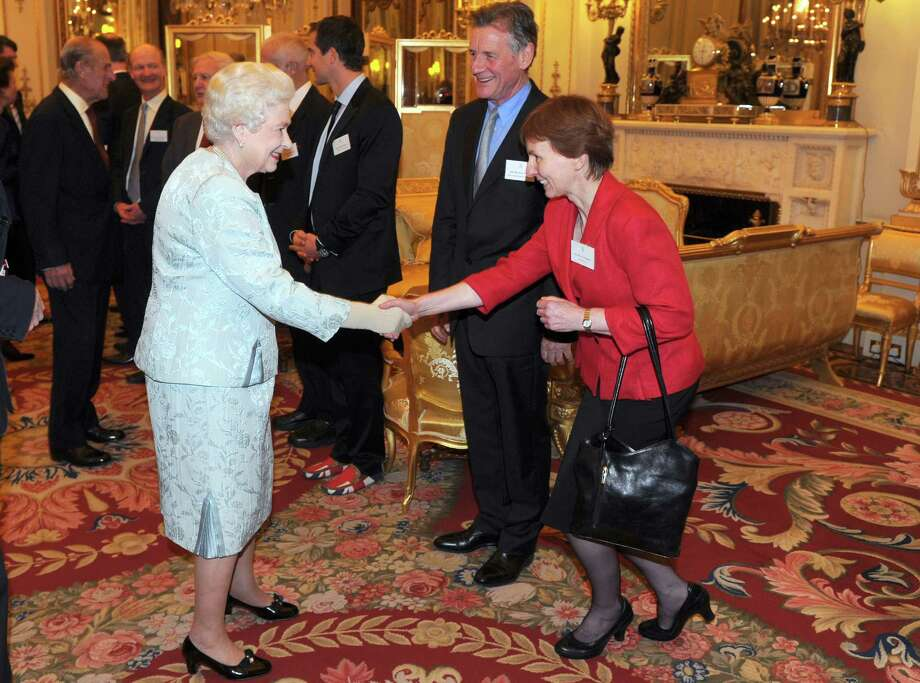 The first Briton in space was a woman,  Helen Sharman, in 1991. Here, Shaman, right, shakes hands with Queen Elizabeth at Buckingham Palace in London on December 8, 2011. Photo: ANTHONY DEVLIN, AFP/Getty Images / 2011 AFP