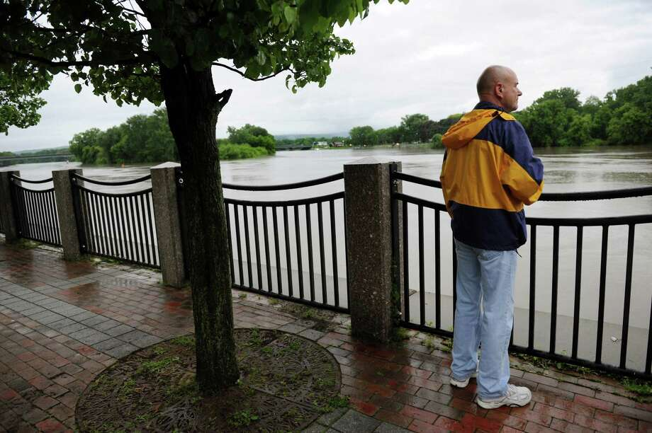 Resident Stan Mlodzianowski, who lives on North Ferry Street, watches the Mohawk River on Thursday, June 13, 2013, at Riverside Park in Schenectady, N.Y. Schenectady police were warning residents about the rising river, which is predicted to crest at 221.2 feet at 7 a.m. on Friday. (Cindy Schultz / Times Union) Photo: Cindy Schultz