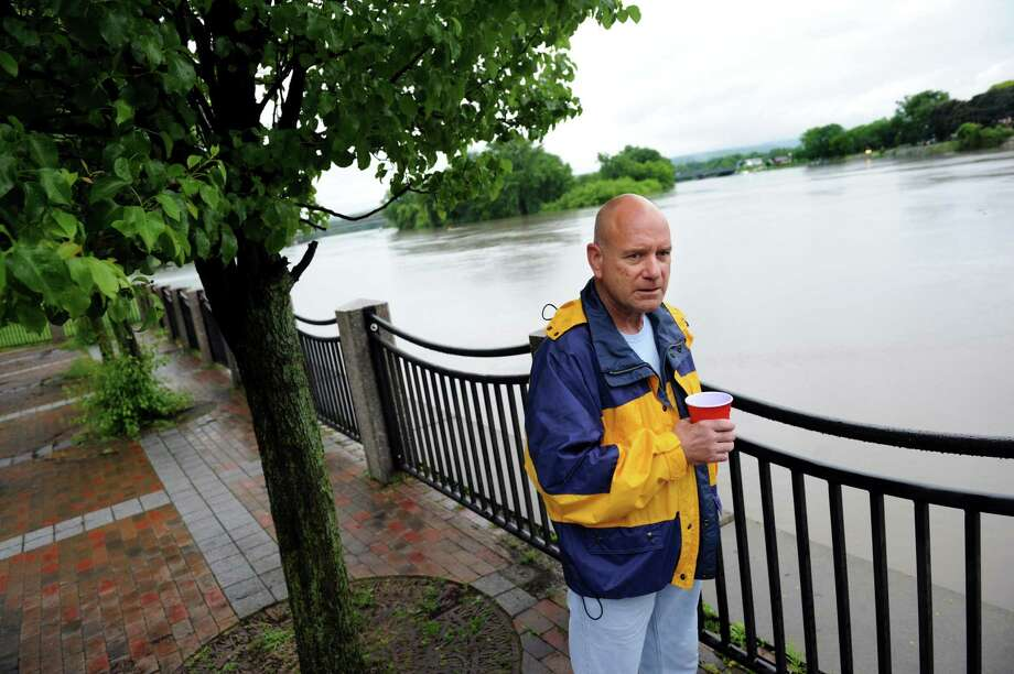 Resident Stan Mlodzianowski, who lives on North Ferry Street, watches the Mohawk River on Thursday, June 13, 2013, at Riverside Park in Schenectady, N.Y. Schenectady police were warning residents about the rising river, which is predicted to crest at 7 a.m. on Friday. (Cindy Schultz / Times Union) Photo: Cindy Schultz
