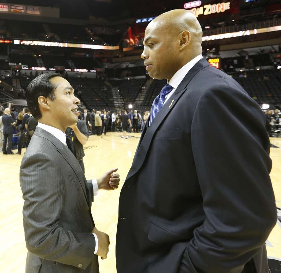 San Antonio Mayor Julian Castro, left, talks to Charles Barkley before the start of Game 4 of the 2013 NBA Finals Thursday June 13, 2013 at the AT&T Center.