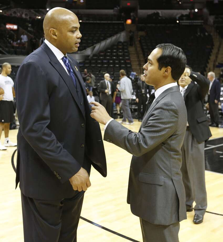 San Antonio Mayor Julian Castro, right, talks to Charles Barkley before the start of Game 4 of the 2013 NBA Finals Thursday June 13, 2013 at the AT&T Center.