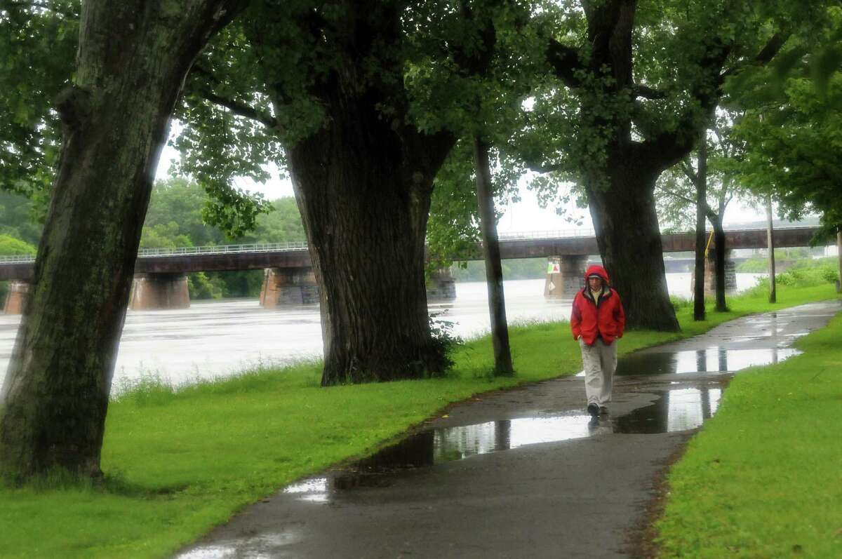Bill Winkler, director of operations, walks along the Mohawk River on Thursday, June 13, 2013, at Riverside Park in Schenectady, N.Y. Schenectady police were warning residents about the rising river, which is predicted to crest at 7 a.m. on Friday. (Cindy Schultz / Times Union)