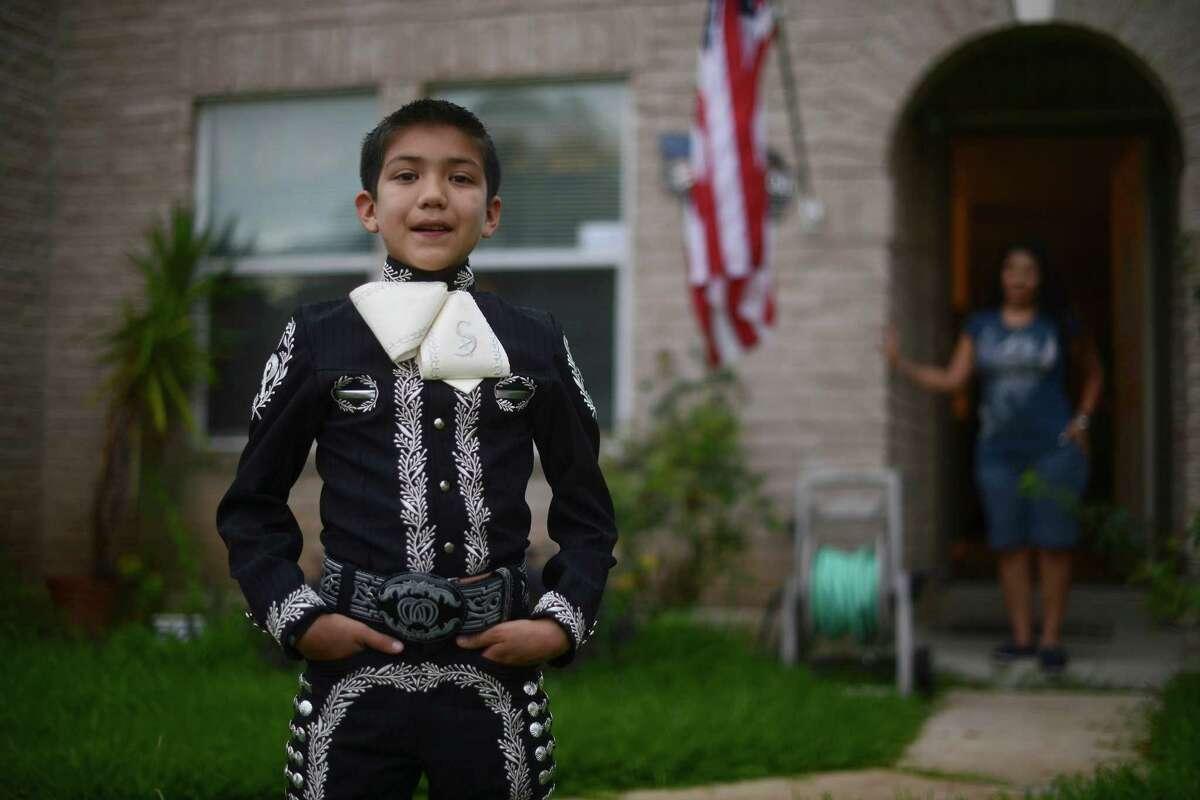 "Sebastien De La Cruz, of San Antonio, rejoices in his talent as a Mariachi singer as well as in being a ""proud American."""