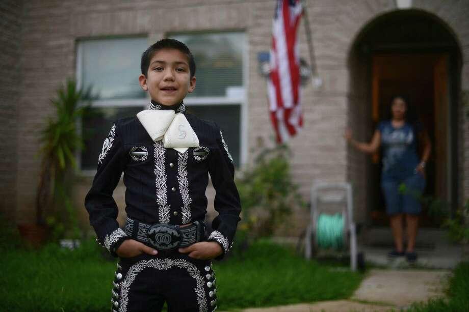 "Sebastien De La Cruz, of San Antonio, rejoices in his talent as a Mariachi singer as well as in being a ""proud American."" Photo: Billy Calzada, Staff / San Antonio Express-News"
