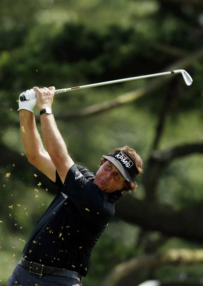 ARDMORE, PA - JUNE 13:  Phil Mickelson of the United States hits his tee shot on the ninth hole during Round One of the 113th U.S. Open at Merion Golf Club on June 13, 2013 in Ardmore, Pennsylvania. Photo: Scott Halleran, Getty Images / 2013 Getty Images