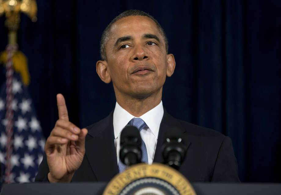 """""""Let's make sure that everybody who is out there working hard ... that they're not going to go bankrupt because they get sick,"""" Barack Obama said in 2012. """"And we got that done."""" Photo: Evan Vucci / Associated Press"""