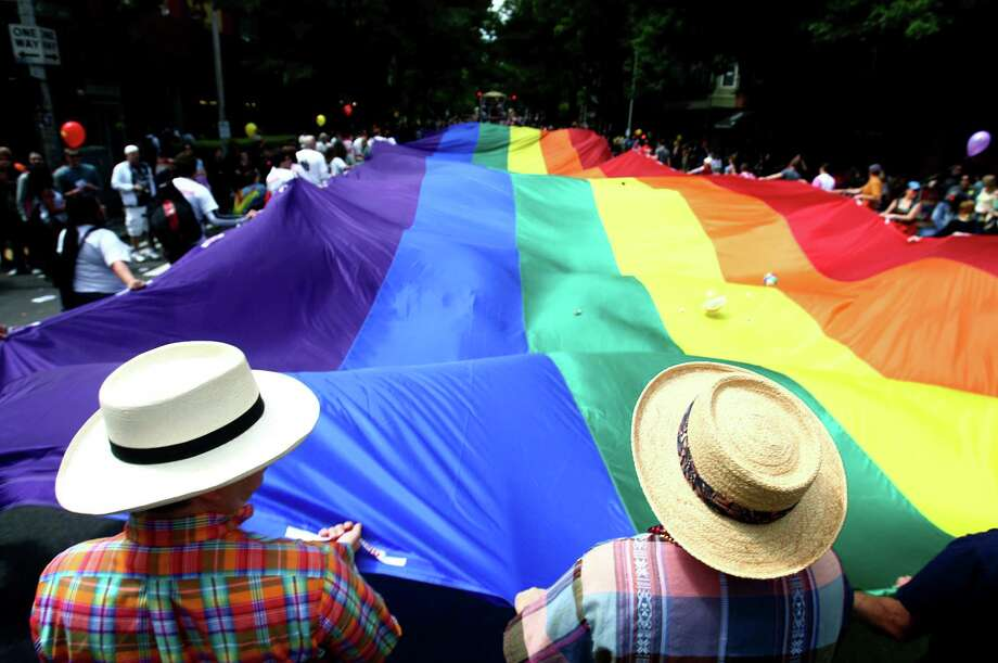 Participants march during Seattle's annual Gay Pride Parade last year. In a new poll, 9 in 10 LGBT adults say society had become more accepting of them in the past decade and that they expect it to be even more open to them in the years ahead. Photo: Joshua Trujillo / Seattlepi.com