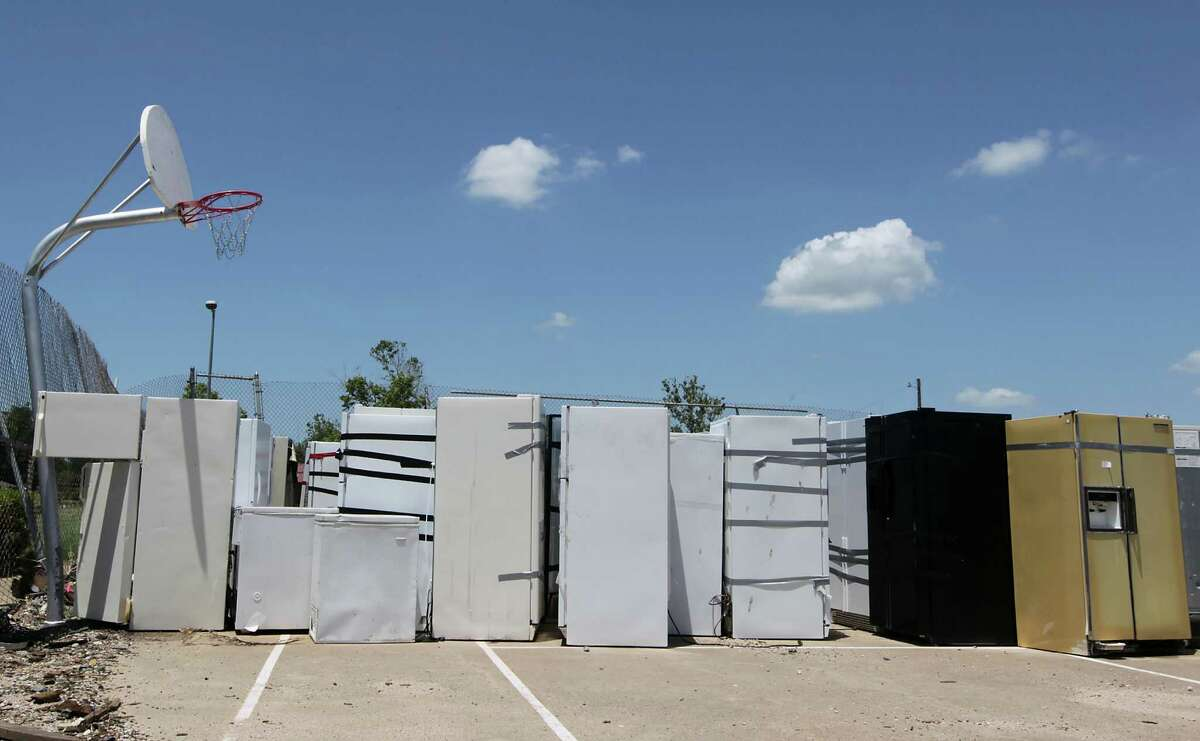 Refrigerators from places ravaged by the April 17 blast are stacked on a basketball court at a West park.