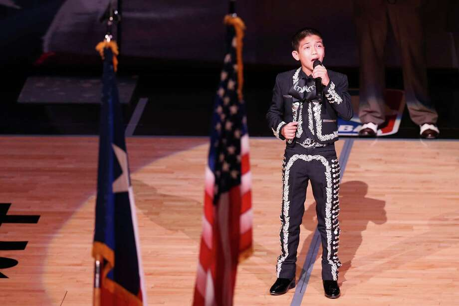 Singer Sebastien De La Cruz performs the United States national anthem before Game Four of the 2013 NBA Finals between the San Antonio Spurs and the Miami Heat at the AT&T Center on June 13, 2013 in San Antonio, Texas. Photo: Mike Ehrmann, Getty Images / 2013 Getty Images