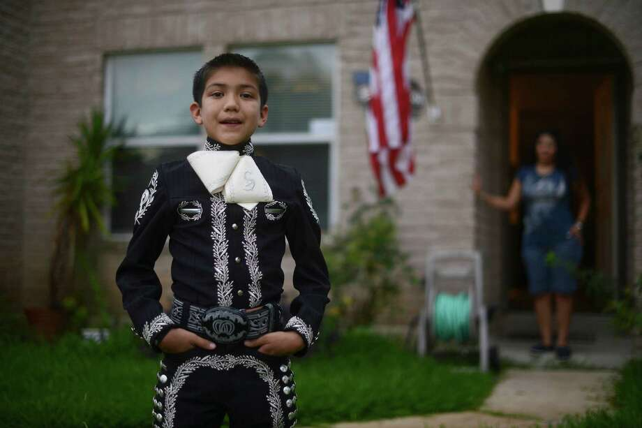 "Sebastien De La Cruz is a young mariachi singer who sang the Star Spangled Banner before the Miami Heat at San Antonio Spurs NBA Championship series game at the AT&T Center on Tuesday. He stands for a portrait at home on Wednesday, June 12, 2013. Sebastien describes himself as a ""proud American."" Photo: Billy Calzada, San Antonio Express-News / San Antonio Express-News"