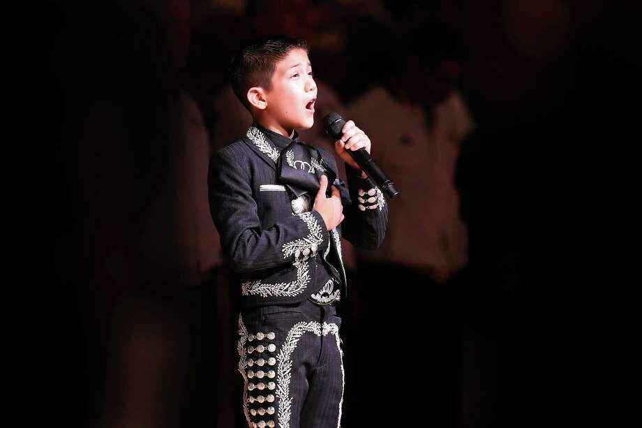 Singer Sebastien De La Cruz performs the United States national anthem before Game Four of the 2013 NBA Finals between the San Antonio Spurs and the Miami Heat at the AT&T Center on June 13, 2013 in San Antonio, Texas. Photo: Christian Petersen, Getty Images / 2013 Getty Images