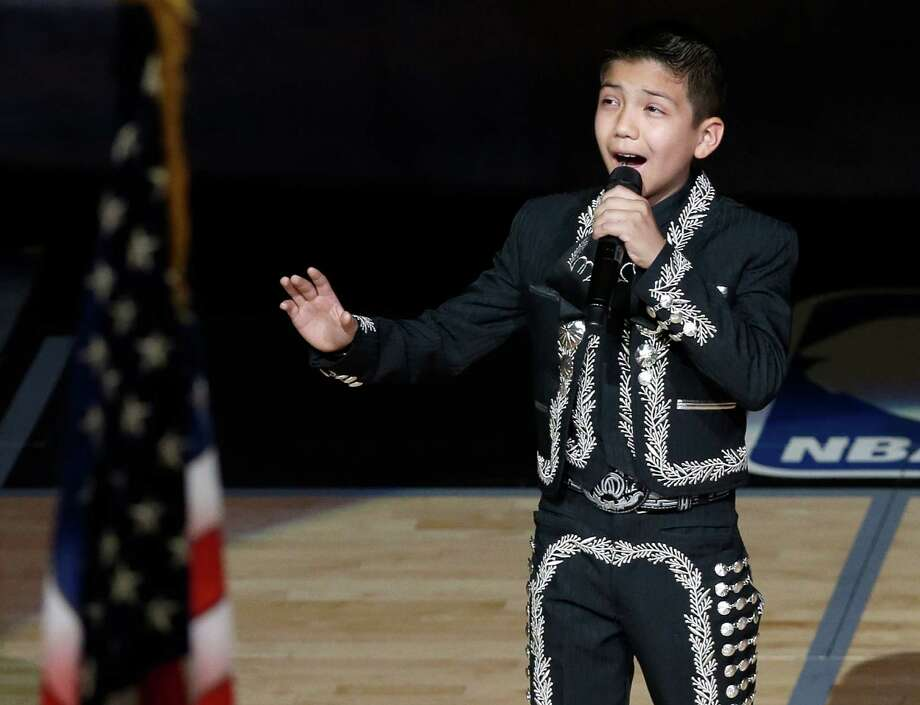 Sebastien De la Cruz sings the U.S. National Anthem before Game 4 of the NBA Finals basketball series between the San Antonio Spurs and the Miami Heat, Thursday, June 13, 2013, in San Antonio. (AP Photo/David J. Phillip) Photo: David J. Phillip, Associated Press / AP