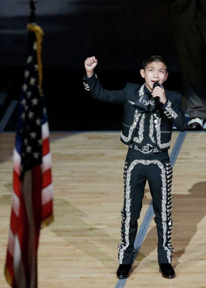 Sebastien De la Cruz sings the national anthem before Game 4 of the NBA Finals basketball series between the San Antonio Spurs and the Miami Heat, Thursday, June 13, 2013, in San Antonio. (AP Photo/David J. Phillip) Photo: David J. Phillip, Associated Press / AP