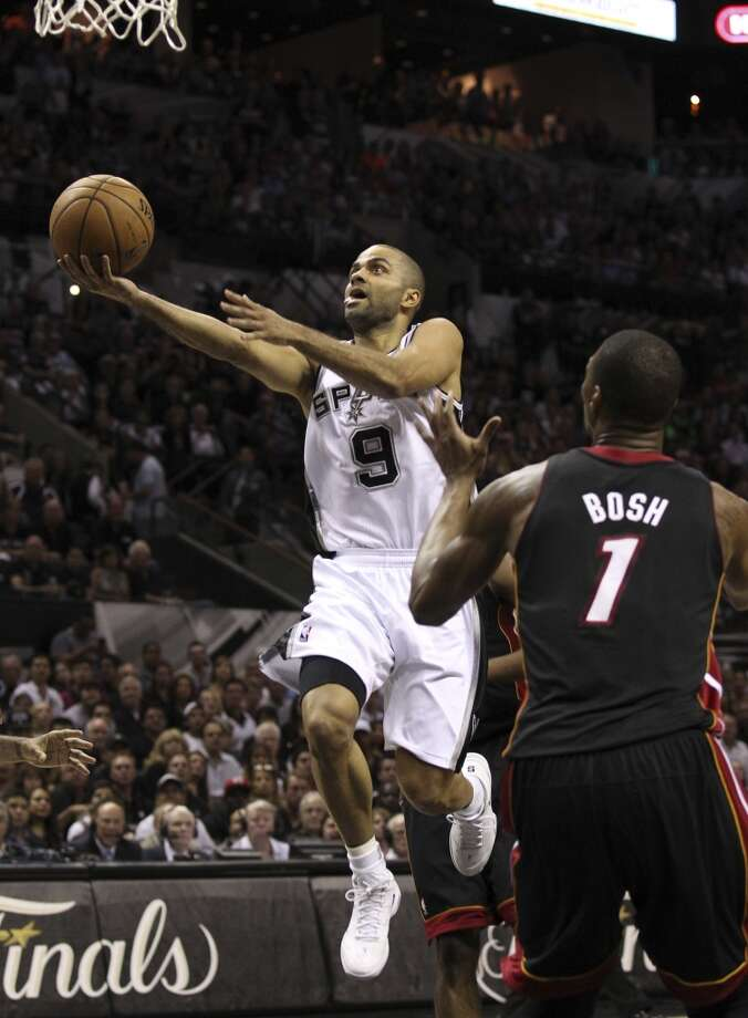 San Antonio Spurs' Tony Parker drives past Miami Heat's Chris Bosh during the first half of Game 4 of the NBA Finals at the AT&T Center on Thursday, June 13, 2013. (Kin Man Hui/San Antonio Express-News)