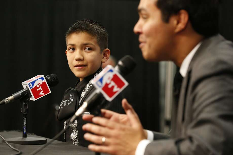 Sebastien De La Cruz looks at San Antonio Mayor Julian Castro before the start of Game 4 of the 2013 NBA Finals Thursday June 13, 2013 at the AT&T Center. (Edward A. Ornelas/San Antonio Express-News)