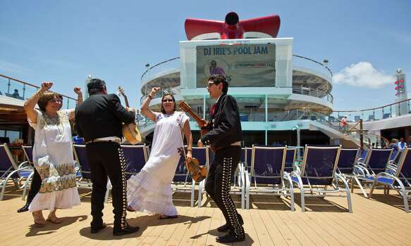 Members of the mariachi group Mariachi Los Gallitos dance as they entertain guests who are boarding the Carnival Triumph cruise ship, Thursday, June 13, 2013, at the Port of Galveston in Galveston. Photo: Nick De La Torre, Houston Chronicle / © 2013  Houston Chronicle