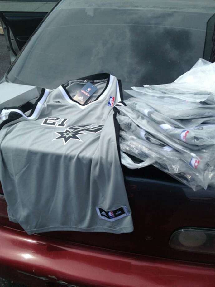 Counterfeit jerseys (Tim Duncan's 21) were seized from a vendor on Military Highway by the feds. Photo: Courtesy Photo