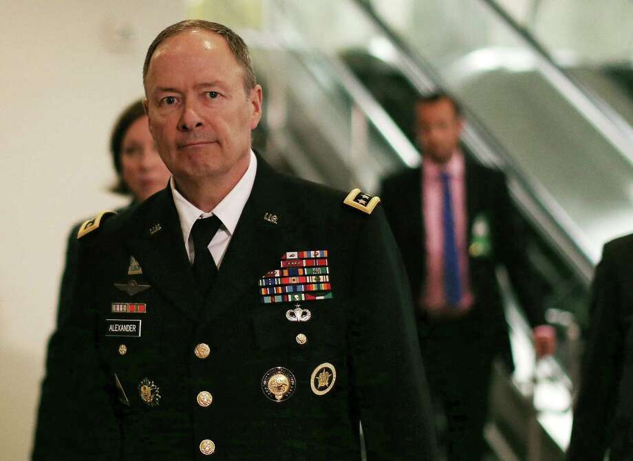 Gen. Keith Alexander, the NSA director, walks to a closed-door meeting of the Senate Intelligence Committee, whose members are not happy about the agency leaks. Photo: Mark Wilson / Getty Images