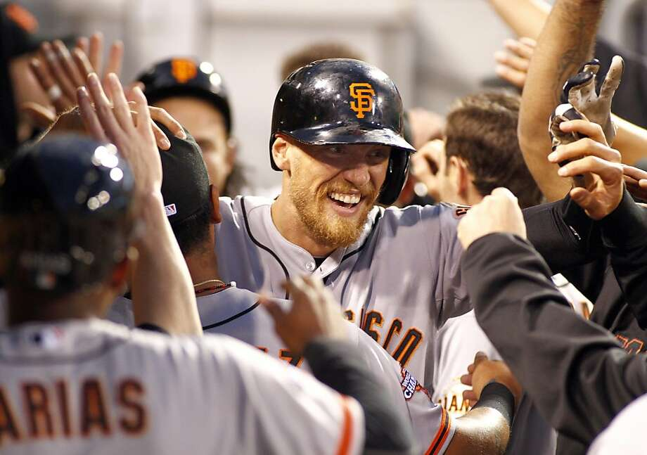 Hunter Pence (center) made it 9-0 with his three-run homer in the sixth inning. Photo: Justin K. Aller, Getty Images