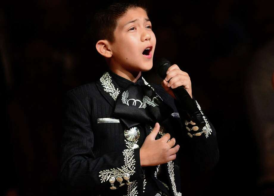 Sebastien De La Cruz, known as San Antonios Little Mariachi, sings the national anthem prior to the start of game 4 in the NBA finals between the San Antonio Spurs and the Miami Heat on June 13, 2013 in San Antonio, Texas. Photo: FREDERIC J. BROWN, AFP/Getty Images / AFP