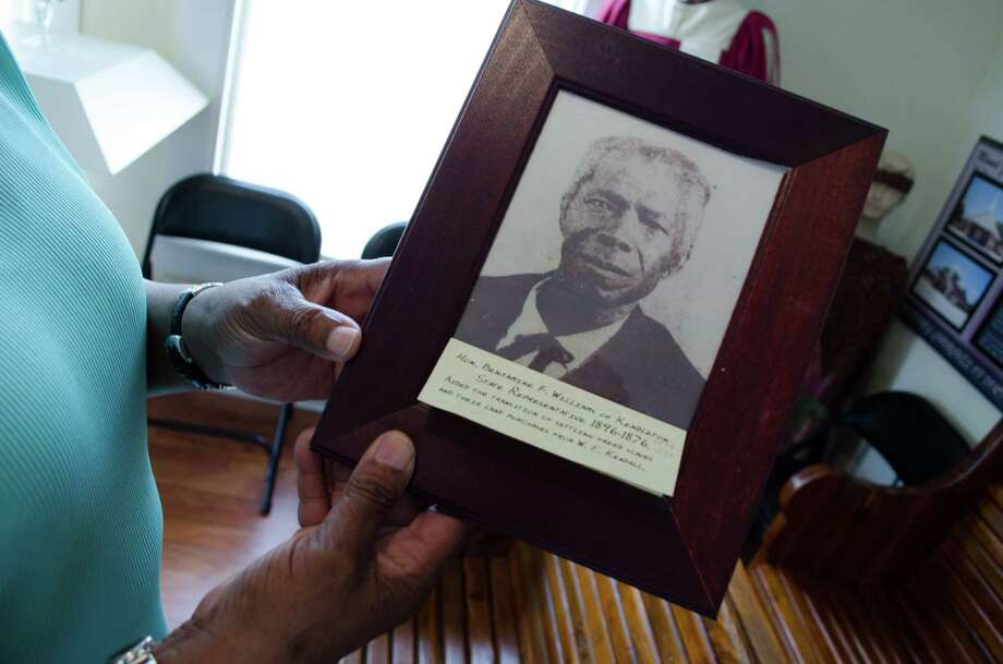 Mable Huff York showing a photograph of Benjamin F. Williams, a State Representative from 1876-1896 in Kendleton, Wednesday, June 12th, 2013. (Jamaal Ellis / For the Houston Chronicle) Photo: Jamaal Ellis, For The Chronicle / ©2013 Houston Chronicle