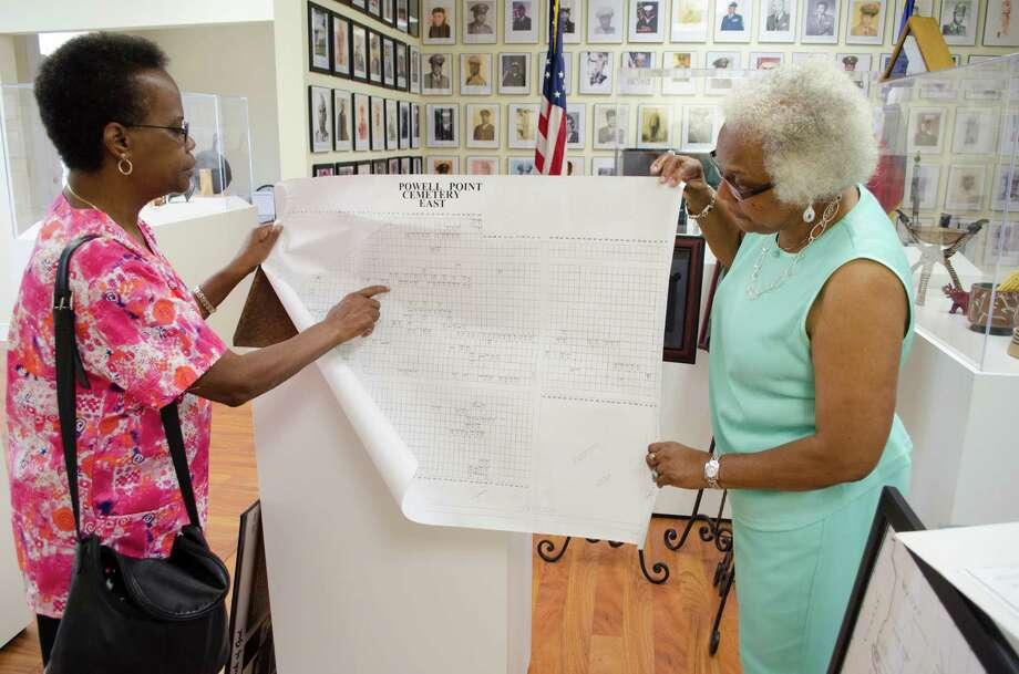 Belinda Battle and Mable Huff York showing a map of cemetery plots of the Powell Point Cemetery - East at the Fort Bend County Heritage Unlimited Museum in Kendleton, Wednesday, June 12th, 2013. (Jamaal Ellis / For the Houston Chronicle) Photo: Jamaal Ellis, For The Chronicle / ©2013 Houston Chronicle