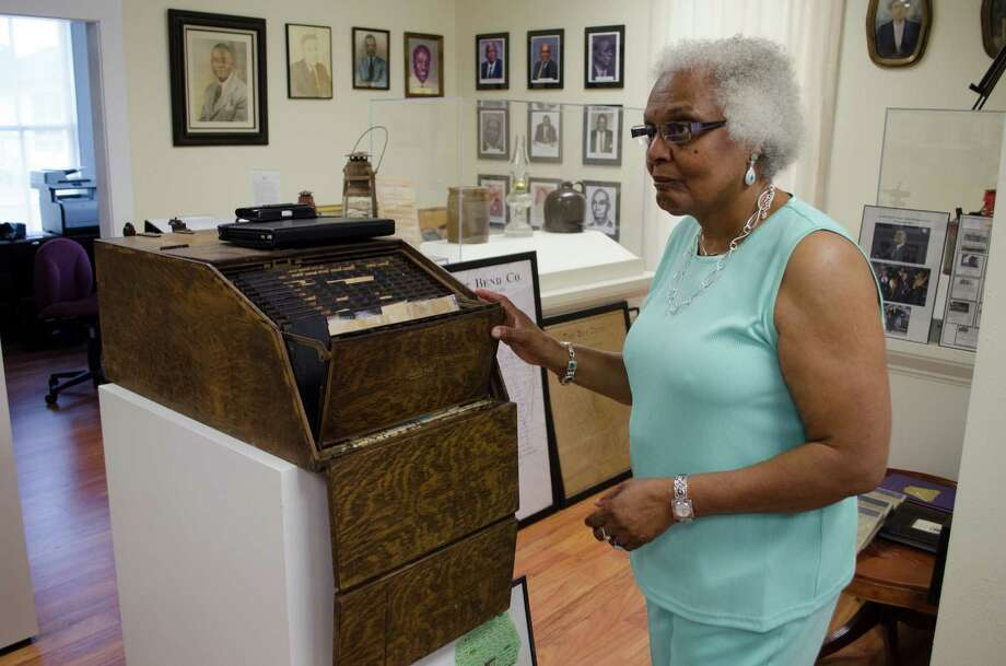 Mable Huff York showing the deposit box from the General Store of Kendleton, which was torn down last year, at the Fort Bend County Heritage Unlimited Museum, in Kendleton, Wednesday, June 12th, 2013. (Jamaal Ellis / For the Houston Chronicle) Photo: Jamaal Ellis, For The Chronicle / ©2013 Houston Chronicle