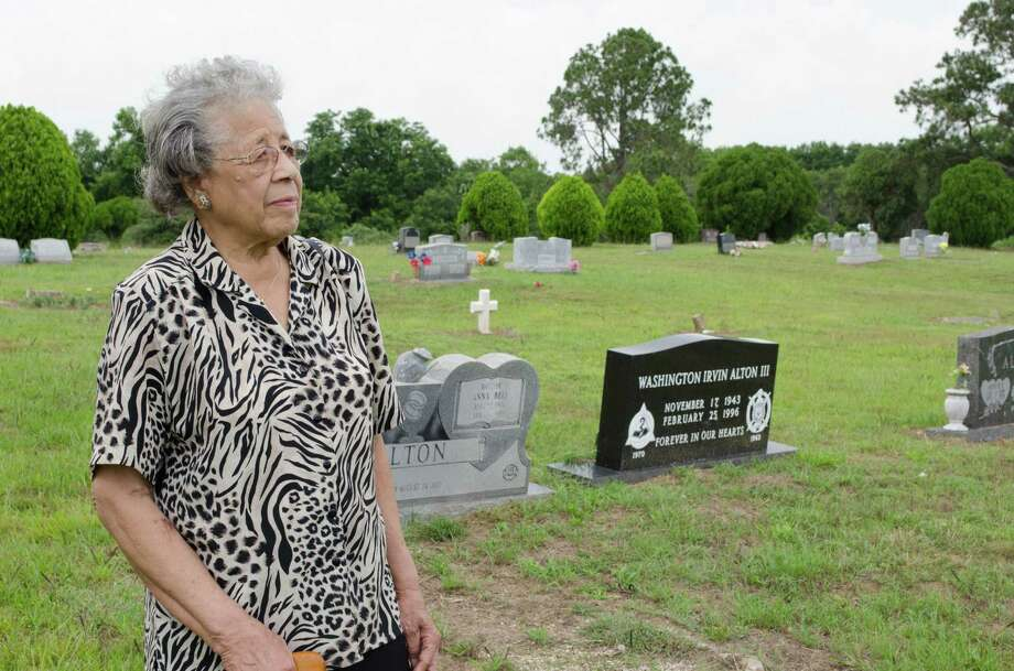 Wilma White looking towards her Great Grandfather, George Washington Alton's grave in Powell Point Cemetery Wednesday, June 12th, 2013, in Kendleton. (Jamaal Ellis / For the Houston Chronicle) Photo: Jamaal Ellis, For The Chronicle / ©2013 Houston Chronicle