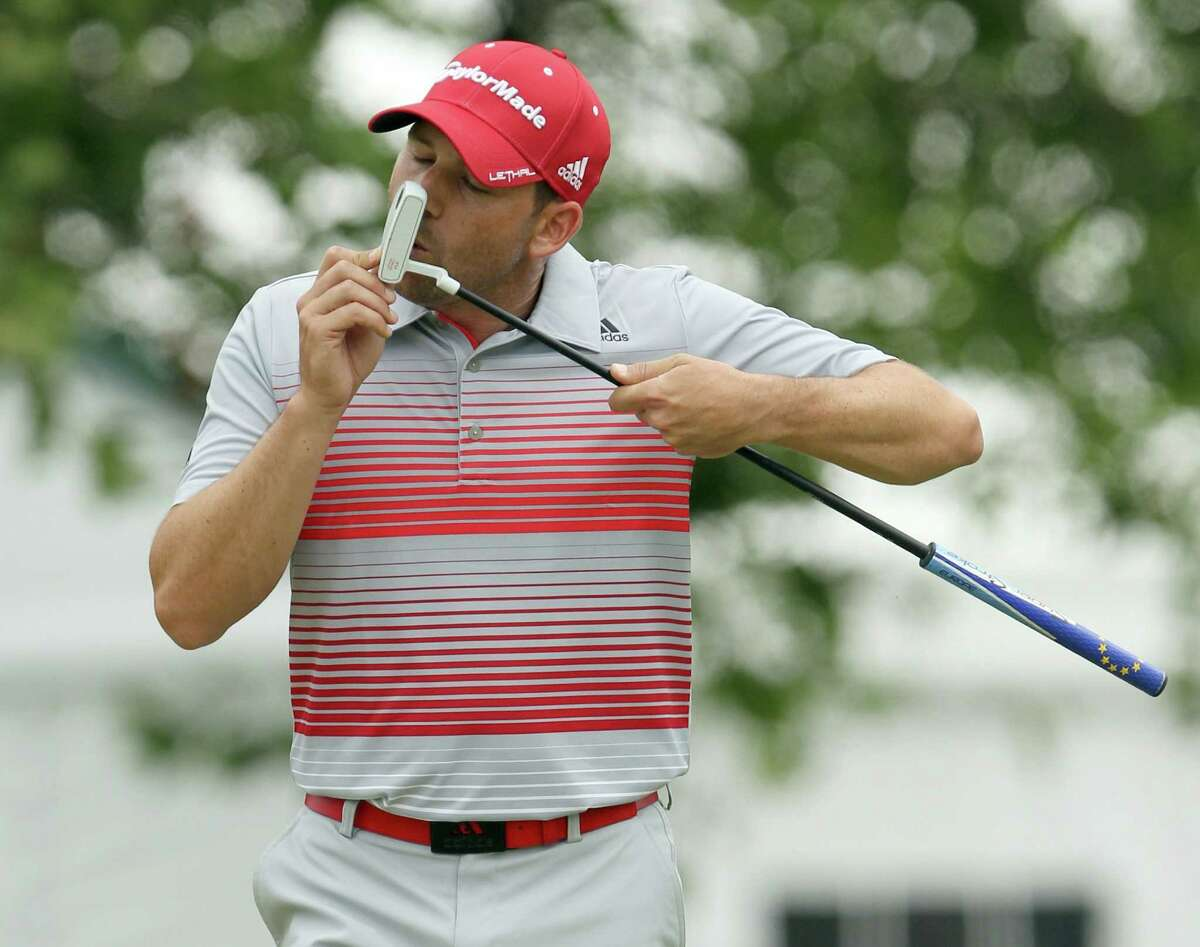 Sergio Garcia interacts with his putter after missing a par opportunity on No. 18 en route to a 3-over 73.