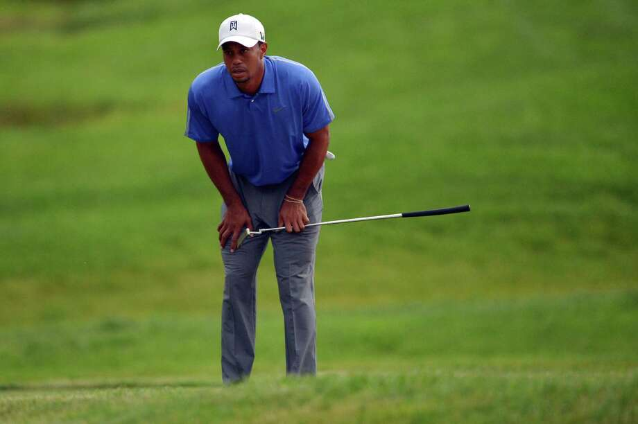 ARDMORE, PA - JUNE 13:  Tiger Woods of the United States reacts to missing a putt  on the ninth hole during Round One of the 113th U.S. Open at Merion Golf Club on June 13, 2013 in Ardmore, Pennsylvania. Photo: Drew Hallowell, Getty Images / 2013 Getty Images