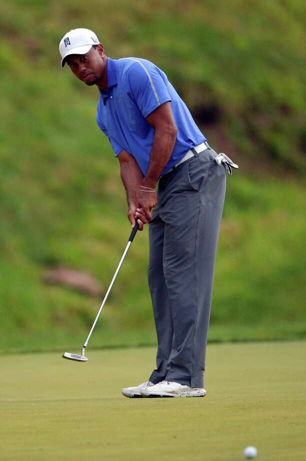 ARDMORE, PA - JUNE 13: Tiger Woods of the United States putts on the ninth hole during Round One of the 113th U.S. Open at Merion Golf Club on June 13, 2013 in Ardmore, Pennsylvania. Photo: Drew Hallowell, Getty Images / 2013 Getty Images
