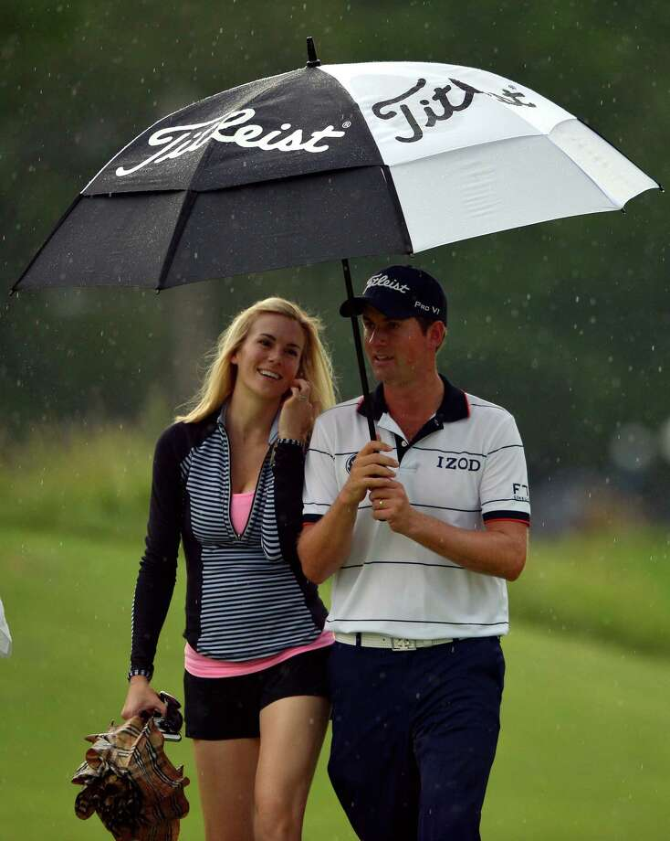 ARDMORE, PA - JUNE 13:  Webb Simpson of the United States walks with his wife Dowd during Round One of the 113th U.S. Open at Merion Golf Club on June 13, 2013 in Ardmore, Pennsylvania. Photo: Drew Hallowell, Getty Images / 2013 Getty Images