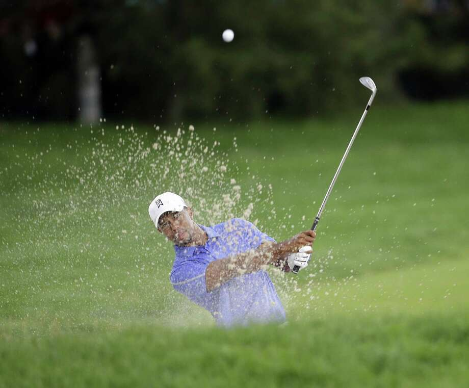 Tiger Woods hits out of the bunker at the second hole during the U.S. Open golf tournament at Merion Golf Club's East Course in Ardmore, Pennsylvania, Thursday, June 13, 2013. (Yong Kim/Philadelphia Daily News/MCT) Photo: Yong Kim, McClatchy-Tribune News Service / Philadelphia Daily News