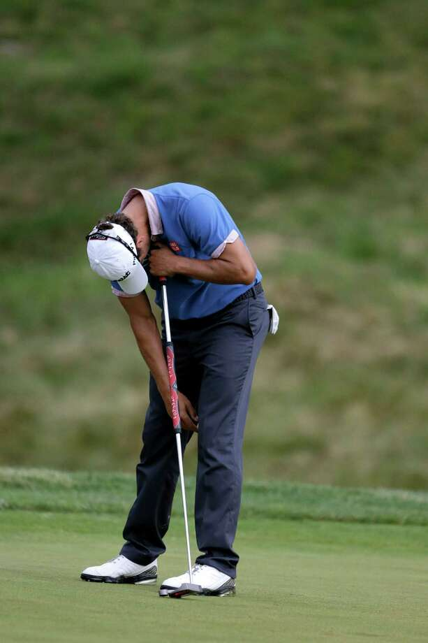 Adam Scott, of Australia, reacts after a missed out on the ninth hole during the first round of the U.S. Open golf tournament at Merion Golf Club, Thursday, June 13, 2013, in Ardmore, Pa. (AP Photo/Darron Cummings) Photo: Darron Cummings, Associated Press / AP