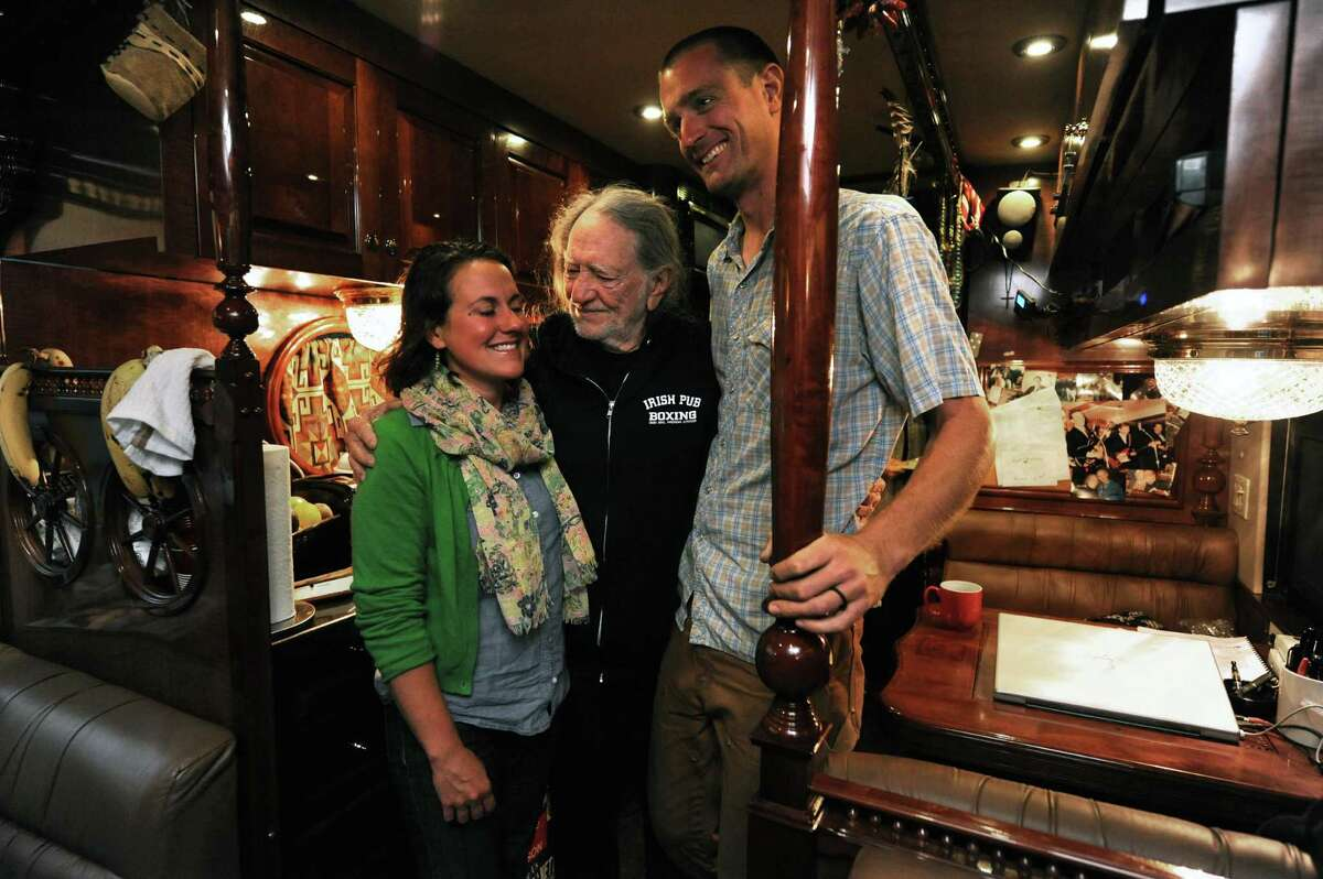Country music legend Willie Nelson, center, greets farmers Cara Fraver and Luke Deikis owners of Quincy Farm in Easton during a stop to promote the announcement of Farm Aid concert at SPAC in September on Thursday June 13, 2013 in Colonie, N.Y. (Michael P. Farrell/Times Union)