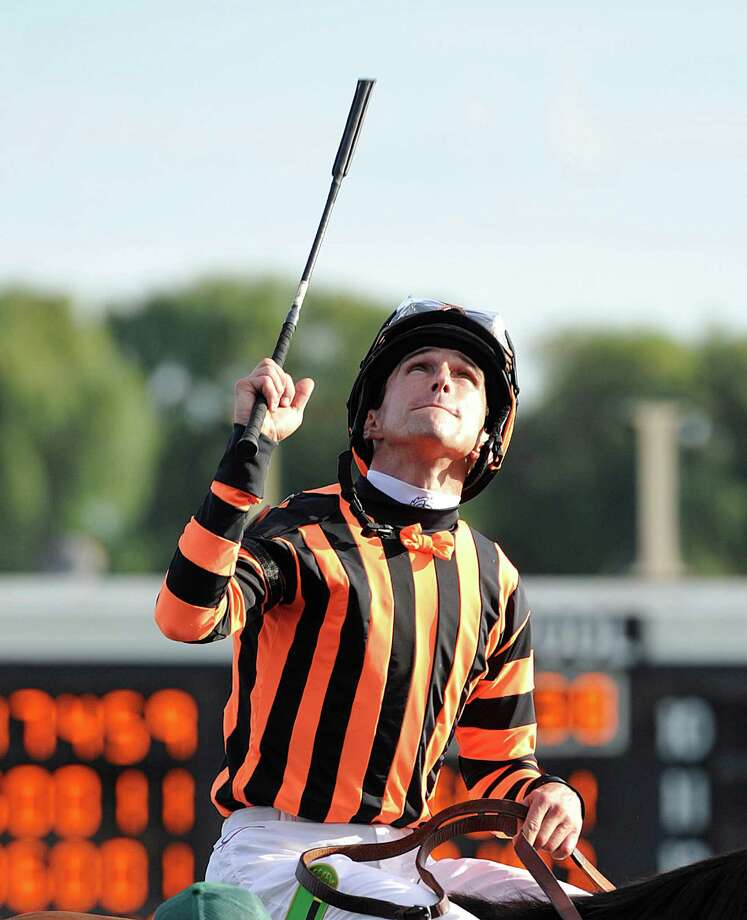 FILE - In this Aug. 18, 2012, file photo, jockey Ramon A. Dominguez, aboard Little Mike, celebrates after they won the Arlington Million horse race at Arlington Park  in Arlington Heights, Ill. The agent for Dominguez says doctors are optimistic the nation's leading rider will fully recover from a fractured skull. The jockey was injured on Firday, Jan. 2012,when his mount Convocation stumbled and fell during a race at Aqueduct race track in New York. Convocation bounced up, and did not appear seriously injured. (AP Photo/Jim Prisching, File) Photo: Jim Prisching / FR59933 AP