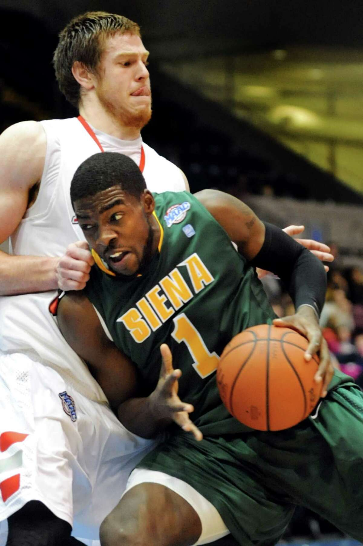 Siena's O.D. Anosike (1), right, tries to get past Marist's Adam Kemp (50) during their first round MAAC Championship basketball game on Friday, March 8, 2013, at MassMutual Center in Springfield, Mass. (Cindy Schultz / Times Union)