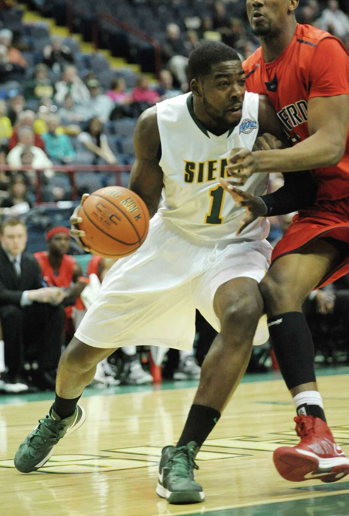 O.D. Anosike of Siena, left, drives towards the basket around a Radford defender during their game at the Times Union Center on Sunday, Feb. 24, 2013 in Albany, NY. (Paul Buckowski / Times Union)