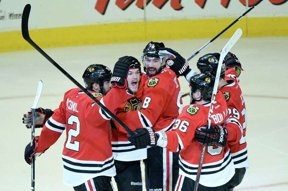CHICAGO, IL - JUNE 12:  (L-R) Michal Rozsival #32, Andrew Shaw #65, Nick Leddy #8, Dave Bolland #36 and Bryan Bickell #29 of the Chicago Blackhawks celebrate after Shaw scored the game-winning goal in the third overtime against the Boston Bruins  in Game One of the 2013 NHL Stanley Cup Final at United Center on June 12, 2013 in Chicago, Illinois.  (Photo by Harry How/Getty Images) Photo: Harry How