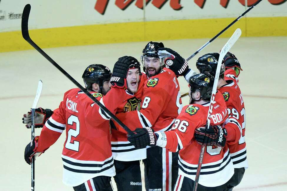 CHICAGO, IL - JUNE 12: (L-R) Michal Rozsival #32, Andrew Shaw #65, Nick Leddy #8, Dave Bolland #36 and Bryan Bickell #29 of the Chicago Blackhawks celebrate after Shaw scored the game-winning goal in the third overtime against the Boston Bruins in Game One of the 2013 NHL Stanley Cup Final at United Center on June 12, 2013 in Chicago, Illinois. (Photo by Harry How/Getty Images)