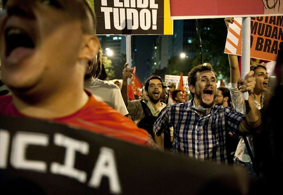 People protest the increase in bus and subway fares in Rio de Janeiro, Thursday, Brazil, June 13, 2013. Thousands of protesters are taking to the streets in Brazil's two biggest cities, protesting against 10-cent hikes in bus and subway fares. (AP Photo/Nicolas Tanner) Photo: Nicolas Tanner, Associated Press